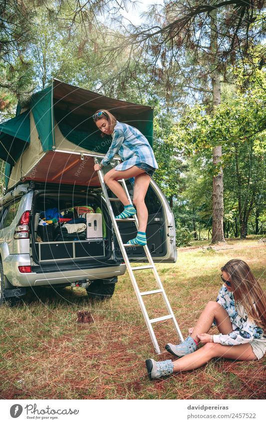 Woman descending ladder form tent over car Human being Nature Vacation & Travel Summer Landscape Relaxation Joy Forest Mountain Adults Lifestyle Autumn Grass