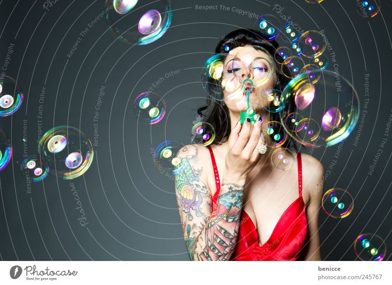 bubbles Woman Human being Soap bubble Blow Tattoo Tattooed Piercing Playing Isolated (Position) Circle Ring Joy Funny Contrast Diva