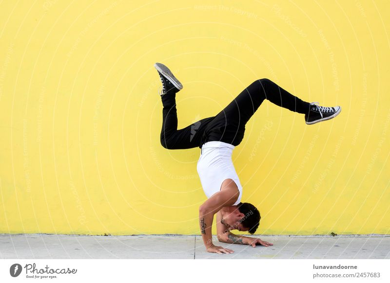 Man practicing yoga, forearm balance on a yellow wall Human being Youth (Young adults) Town Joy 18 - 30 years Adults Lifestyle Healthy Sports Movement Bright