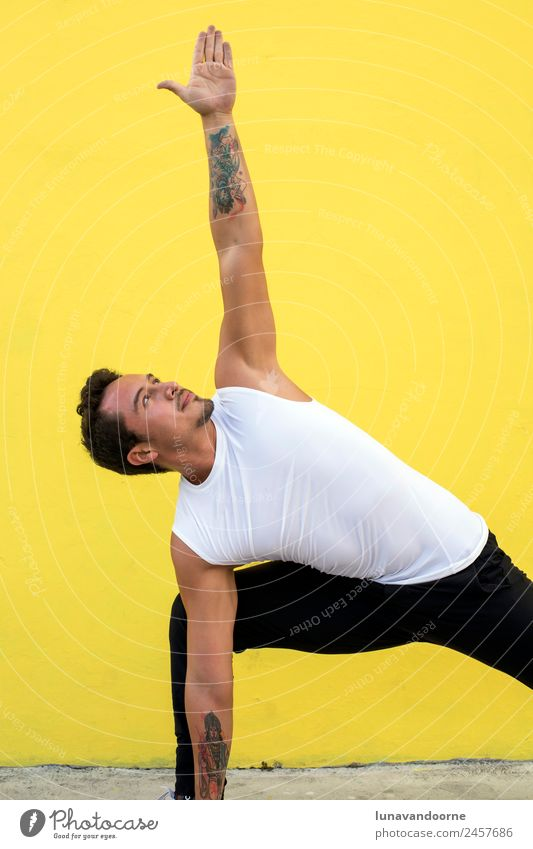 Mexican yoga teacher practicing side angle pose Lifestyle Joy Sports Fitness Sports Training Yoga Masculine Man Adults 1 Human being 18 - 30 years