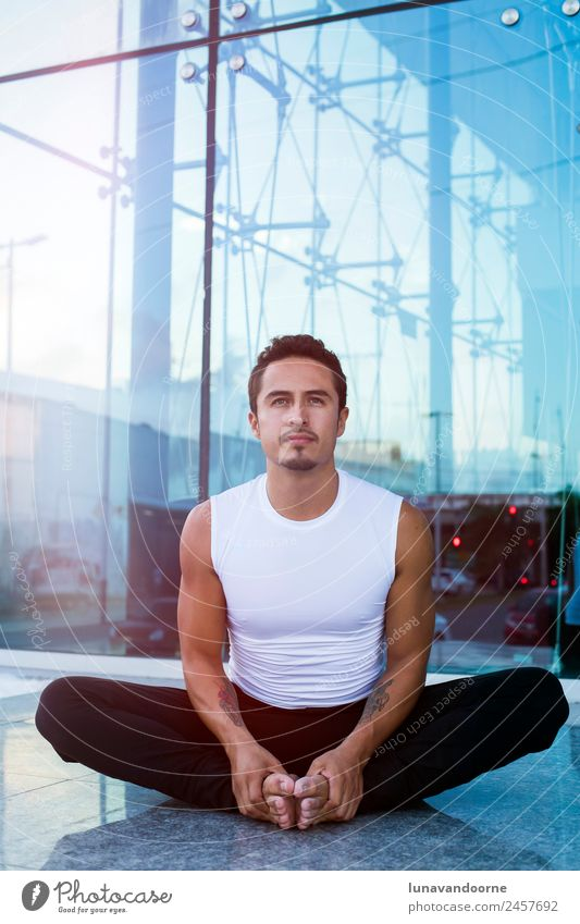 Latin man practicing yoga Lifestyle Sports Fitness Sports Training Yoga Warming up Human being Man Adults 1 18 - 30 years Youth (Young adults) Athletic Success