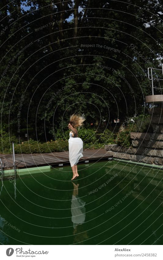 Woman jumps into swimming pool 2 Lifestyle Joy Beautiful Vacation & Travel Tourism Trip Young woman Youth (Young adults) Adults 18 - 30 years Landscape Summer