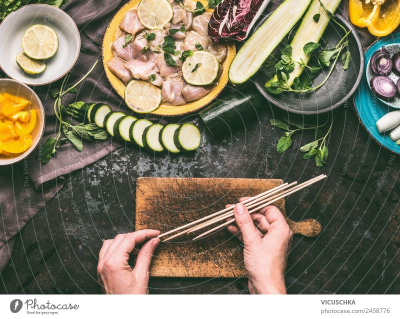Hands holding wooden skewers for chicken grilling Food Meat Vegetable Herbs and spices Nutrition Picnic Crockery Style Design Healthy Eating Summer