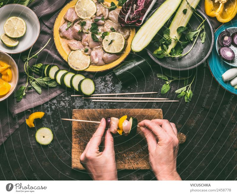 Female hands making chicken skewers with vegetables for grilling Food Meat Vegetable Herbs and spices Cooking oil Nutrition Picnic Organic produce Crockery
