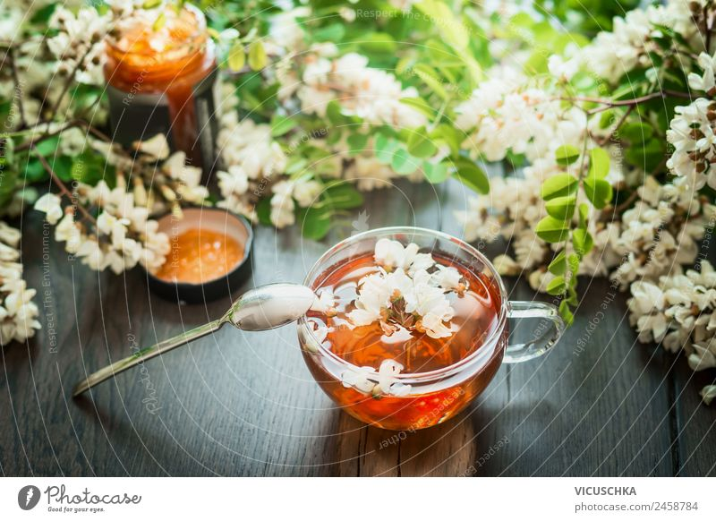 Cup with acacia blossoms Tea with spoon and honey Food Nutrition Beverage Hot drink Design Healthy Alternative medicine Healthy Eating Table Nature Plant Yellow