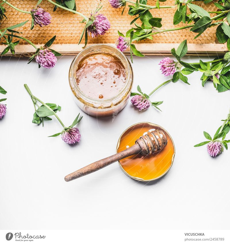 Honey in glass with honeycomb and blossoms Food Dessert Nutrition Organic produce Diet Crockery Glass Spoon Style Design Medical treatment Alternative medicine