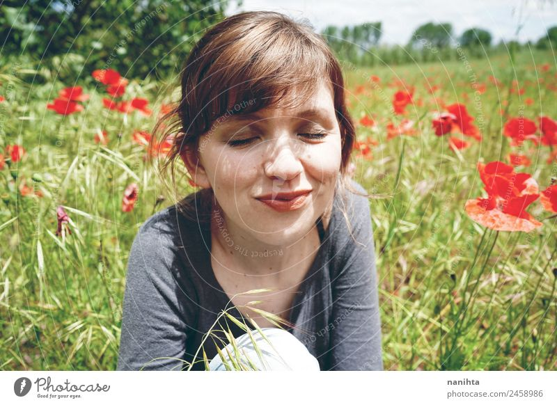 Young happy woman enjoying a sunny day in nature Lifestyle Style Joy Healthy Wellness Well-being Relaxation Human being Feminine Young woman