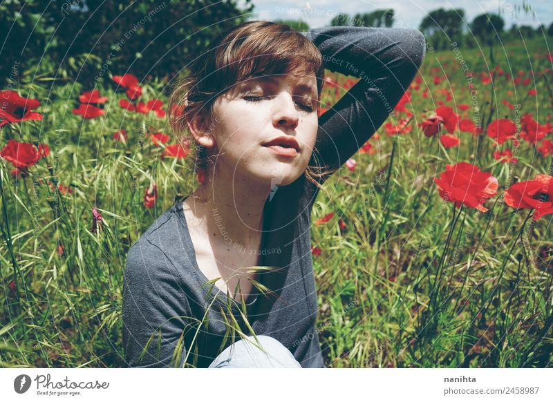 Young woman enjoying a sunny day in nature Human being Nature Youth (Young adults) Summer Beautiful Green Sun Flower Relaxation 18 - 30 years Adults Lifestyle