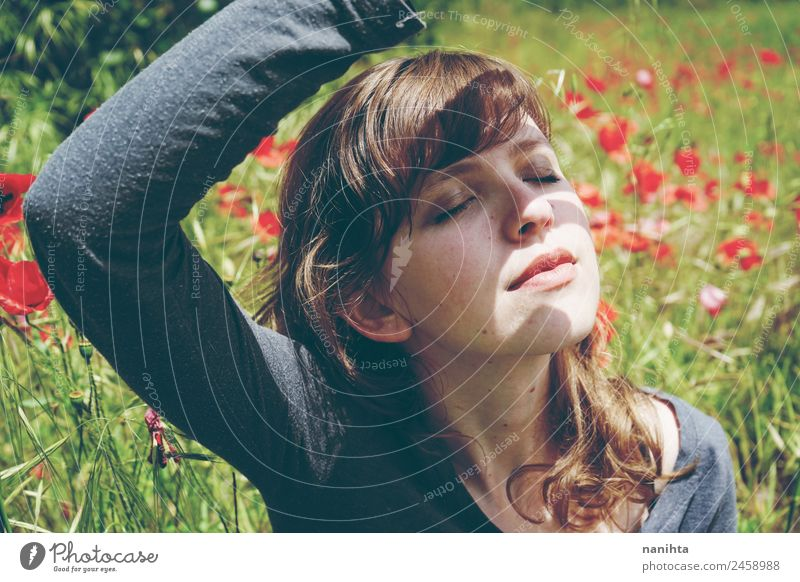 woman in a field of flowers is covering herself from sunlight Woman Human being Nature Youth (Young adults) Young woman Summer Beautiful Flower Relaxation Calm