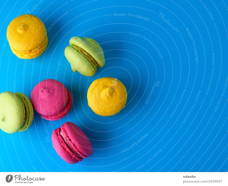 baked cakes of almond flour macarons Cake Dessert Candy Eating Bright Blue Yellow Green Pink Colour Macaron background food colorful Vanilla french