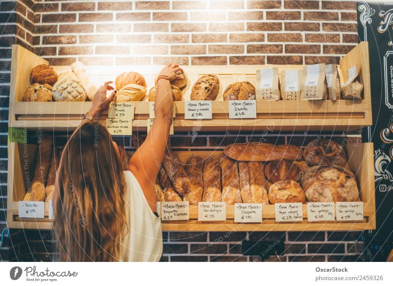Woman sells in bakery. Human being Adults Business Small Food Work and employment Fresh Arrangement Smiling Joie de vivre (Vitality) Shopping Industry