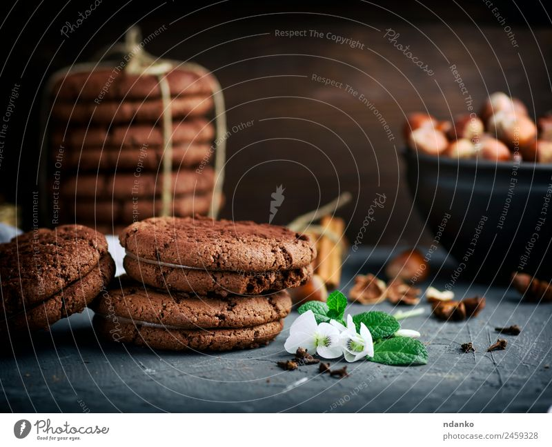 stack of round chocolate cookies Cake Dessert Candy Nutrition Flower Eating Dark Delicious Brown Black background food Stack sweet Baking biscuit Tasty Snack