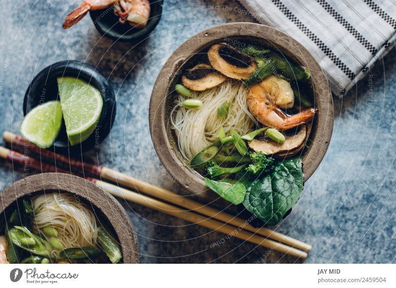 Bowl of Asian Noodle Soup with chopsticks Vegetable Stew Herbs and spices Lunch Dinner Table Pack Hot noodle spaguetti Thai fish asian shrimp miso Mushroom lime
