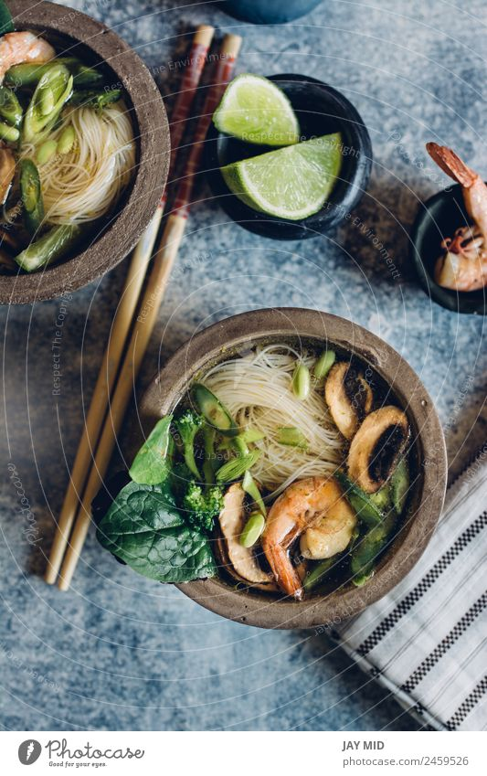 Bowl of Asian Noodle Soup with chopsticks Vegetable Stew Herbs and spices Lunch Dinner Table Pack Hot noodle Thai asian fish shrimp miso Mushroom lime healthy