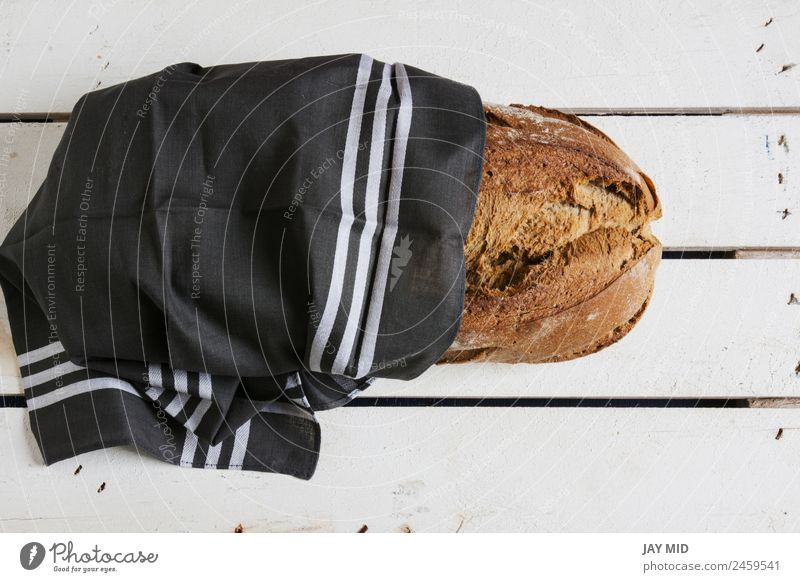 rustic bread, wrapped in striped fabric Food Bread Nutrition Breakfast Organic produce Vegetarian diet Diet Group Cloth Fresh Brown White Tradition breads