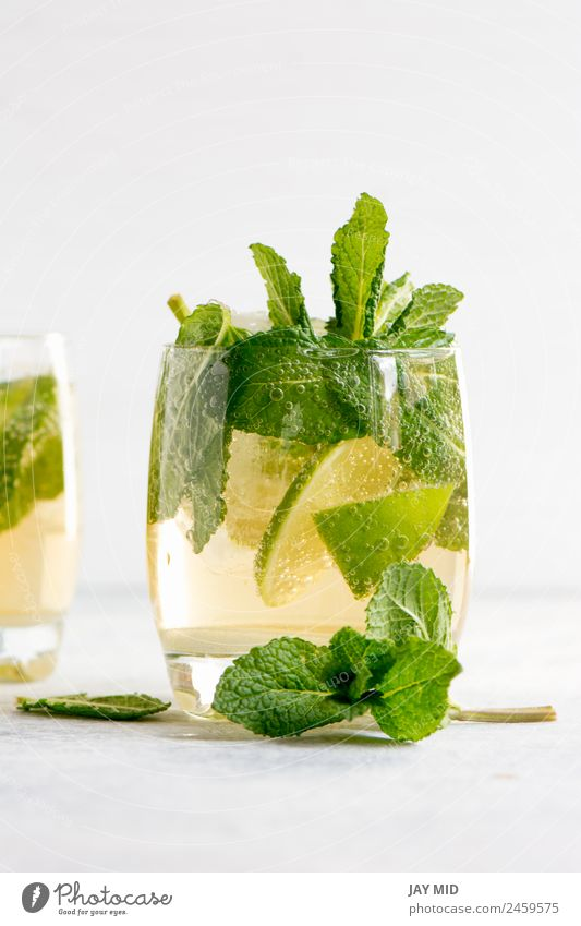 mojito cocktail with rum, lime and soda Summer Green White Leaf Wood Fruit Fresh Glass Table Cool (slang) Herbs and spices Beverage Exotic Refreshment Slice