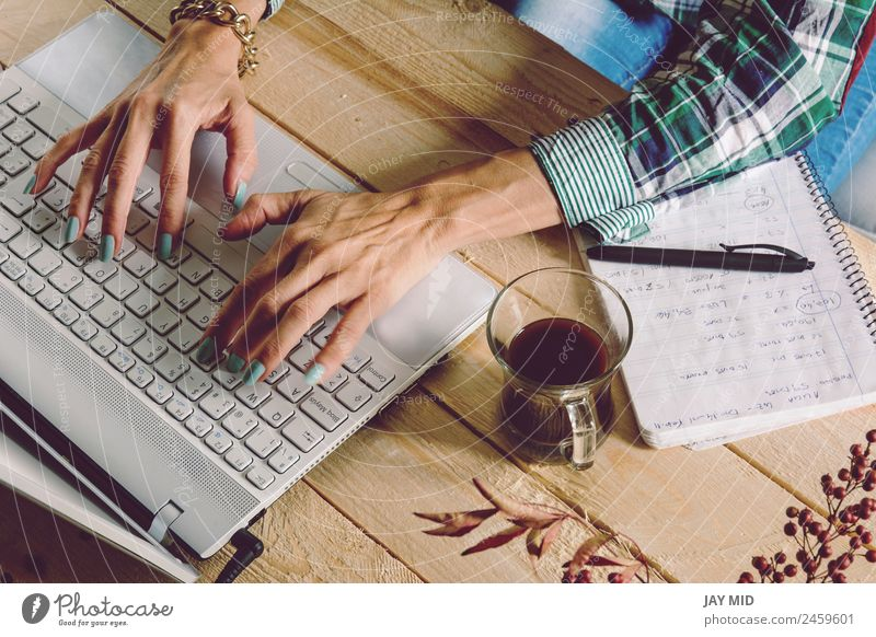 Woman writing on the computer, wearing plaid shirt and casual st Human being Hand Joy Adults Lifestyle Movement Business Work and employment Above