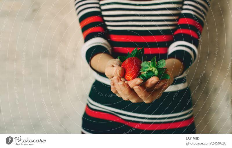Woman holds strawberries in her hands Food Fruit Eating Breakfast Organic produce Vegetarian diet Diet Human being Feminine Adults Hand 1 Nature Leaf Dress