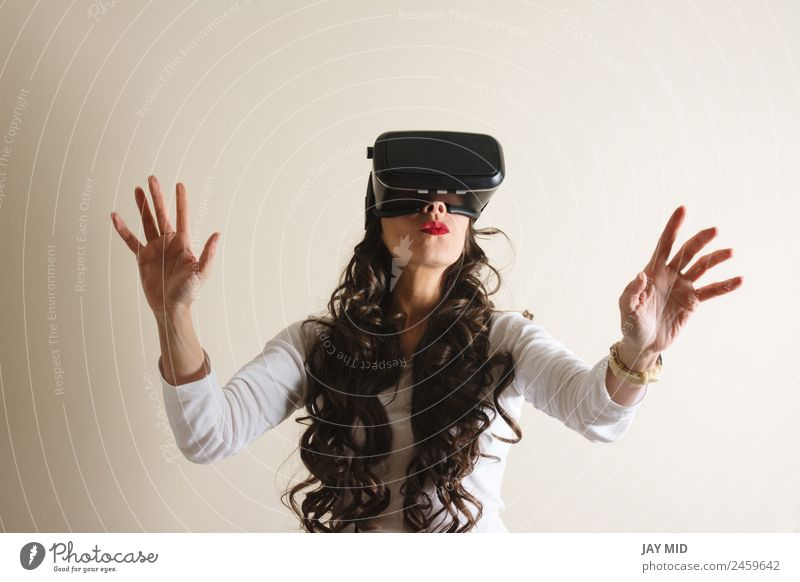 VR glasses:woman living experience with their hands, Woman Human being White Adults Emotions Movement Playing Leisure and hobbies Body Modern Communicate
