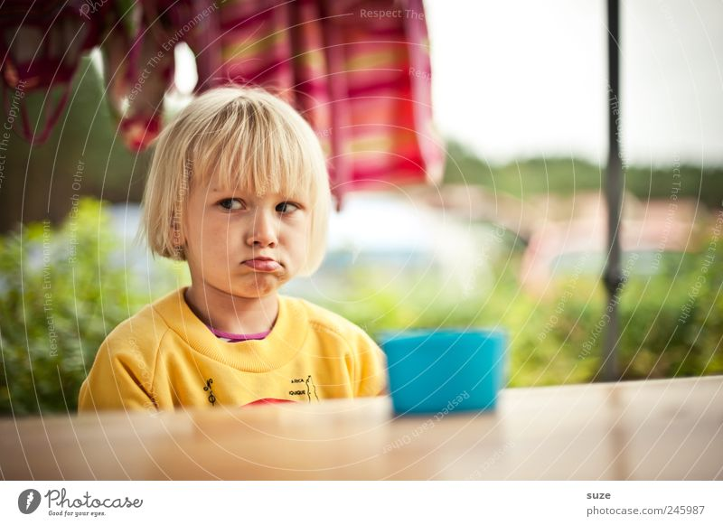 Human being Child Girl Yellow Head Hair and hairstyles Sadness Infancy Blonde Sit Lips Toddler Anger Cup Evil Sweater