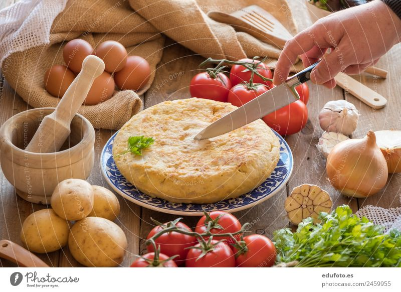 Chef cutting a traditional spanish omelette Vegetable Nutrition Lunch Dinner Plate Lifestyle Healthy Eating Restaurant Natural Green White Spain Baking Basil