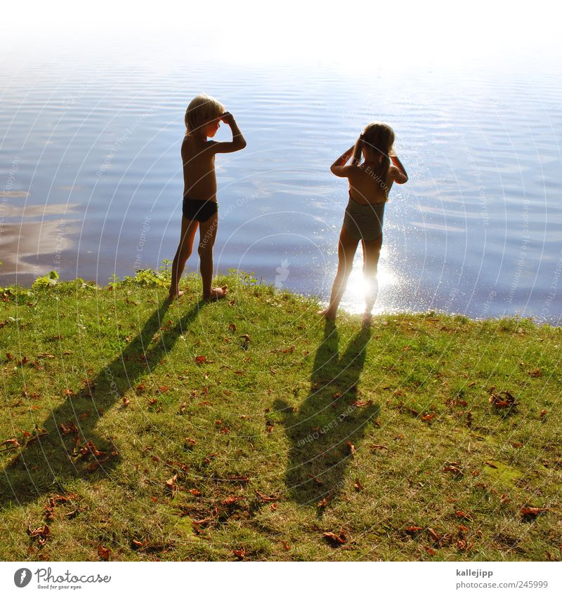 Human being Child Nature Water Girl Life Meadow Boy (child) Grass Environment Coast Lake Waves Earth Swimming & Bathing Infancy