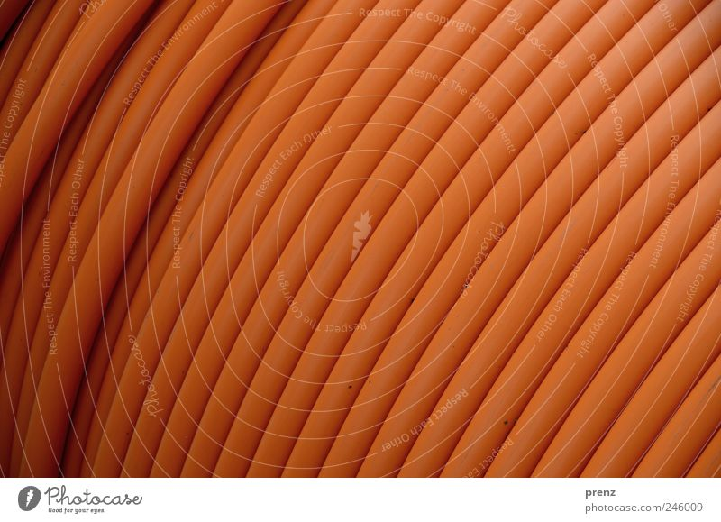 plastic design Plastic Brown Pipe Transmission lines Cable Line Wound up Colour photo Exterior shot Close-up Light Shallow depth of field Central perspective
