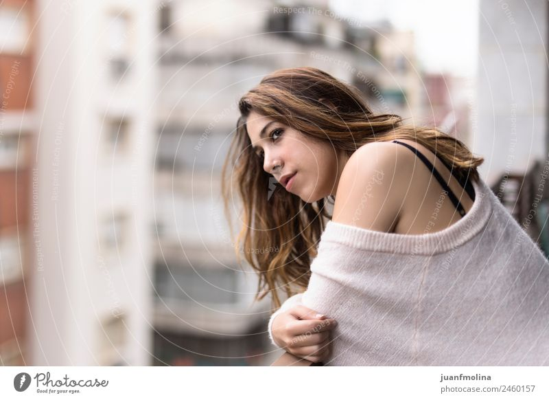 Woman looking from her balcony the city Lifestyle Beautiful Face Flat (apartment) Human being Adults Balcony Street Sweater Think Dream Elegant Emotions