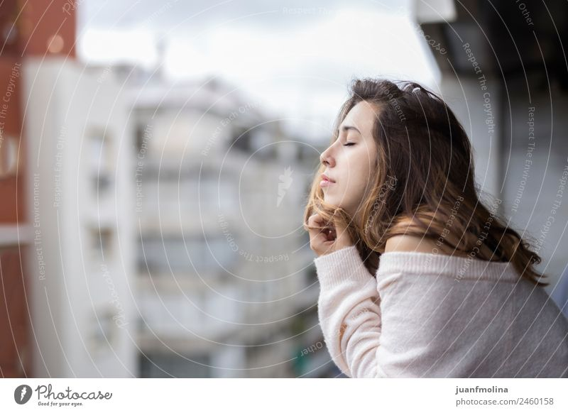 Woman looking from her balcony the city Lifestyle Beautiful Face Flat (apartment) Human being Adults Downtown Balcony Street Sweater Think Authentic Natural