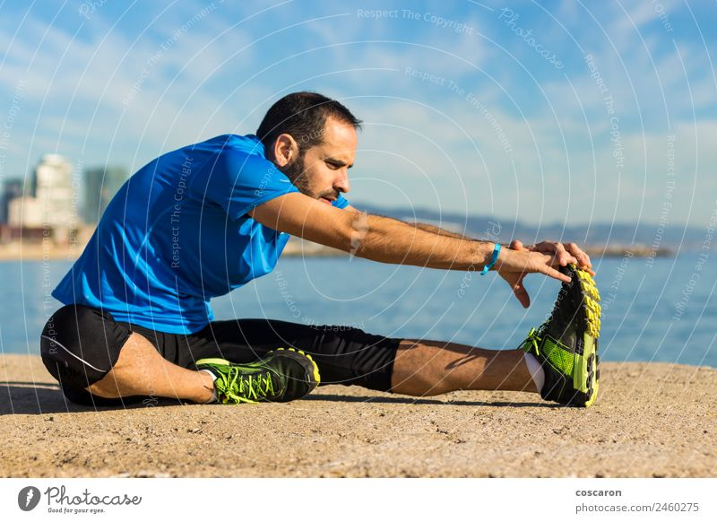 Jogger stretching in the morning on seaside. Lifestyle Body Wellness Relaxation Freedom Beach Ocean Sports Man Adults Nature Horizon Coast Beard Fitness