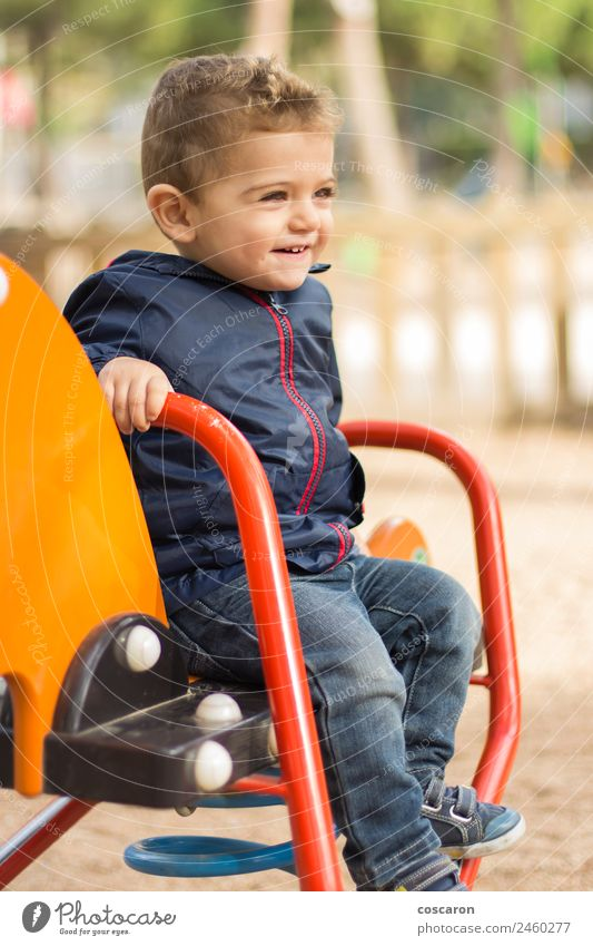 Cute boy playing in the park Joy Happy Face Playing Child Baby Toddler Boy (child) Infancy Mouth Sand Park Blonde Toys Smiling Friendliness Funny New Crazy Wild