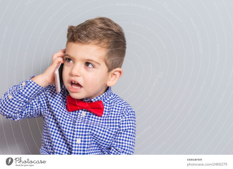 Little boy talking on the phone with copy space Child Human being Man Beautiful White Hand Joy Face Adults To talk Happy Boy (child) Technology Blonde Infancy