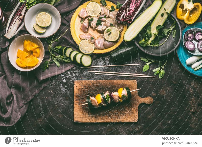Prepare chicken skewers with zucchini and paprika Food Meat Vegetable Herbs and spices Nutrition Lunch Picnic Organic produce Crockery Style Design