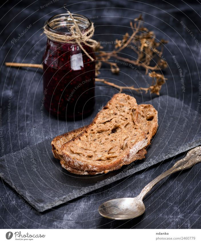 rye bread and a jar of raspberry jam Bread Candy Jam Breakfast Spoon Eating Black Rye piece food background glass sweet Colour photo Deserted