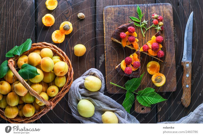apricots and pieces of cheesecake Cheese Fruit Cake Dessert Candy Nutrition Knives Table Eating Fresh Bright Delicious Brown Red White Colour Raspberry Apricot