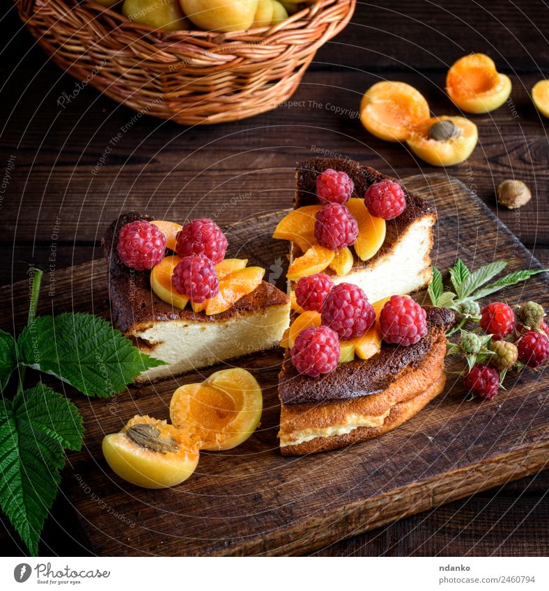 pieces of cottage cheese pie Cheese Fruit Cake Dessert Nutrition Vegetarian diet Table Fresh Delicious Brown Red Colour Raspberry Apricot cheesecake Berries