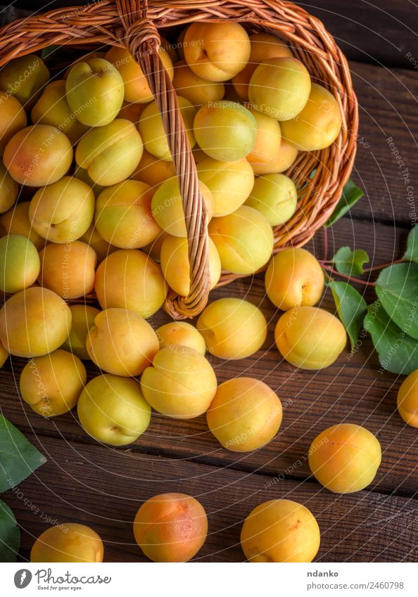 Ripe apricots Fruit Nutrition Vegetarian diet Diet Table Group Nature Leaf Wood Eating Fresh Natural Juicy Brown Yellow Colour Basket agriculture Apricot