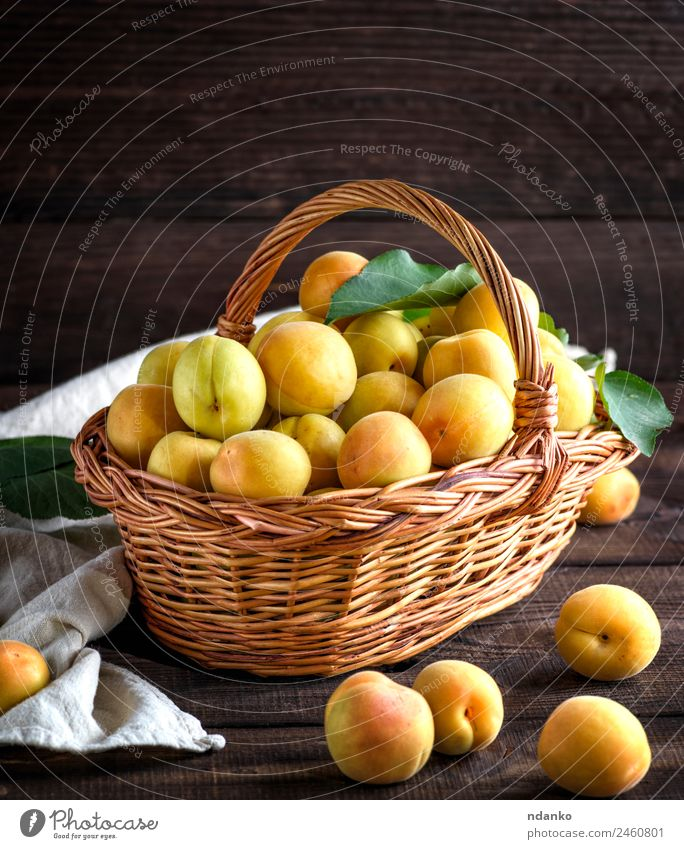 Ripe apricots in a brown wicker basket Fruit Nutrition Vegetarian diet Diet Table Eating Fresh Natural Juicy Brown Yellow Colour Basket agriculture Apricot