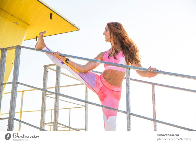 Red-haired woman stretching on the beach Lifestyle Sports Fitness Sports Training Yoga Woman Adults 1 Human being 18 - 30 years Youth (Young adults) Curl