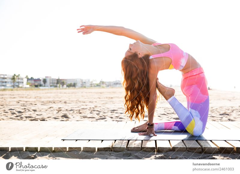 Woman practicing yoga on the beach Lifestyle Sports Fitness Sports Training Yoga Human being Feminine Adults 1 18 - 30 years Youth (Young adults) Clothing