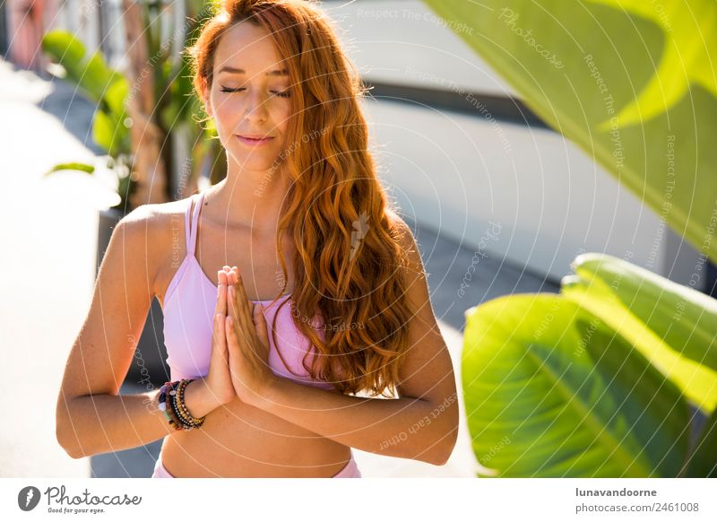 Spanish woman meditating in a tropical background Lifestyle Joy Sports Fitness Sports Training Yoga Young man Youth (Young adults) Woman Adults 1 Human being