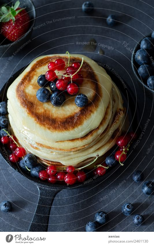 Small pancakes with blueberries and red currants in a cast iron pan Pancake Redcurrant Blueberry fruit Dough Baked goods Strawberry sugar syrup Breakfast Buffet