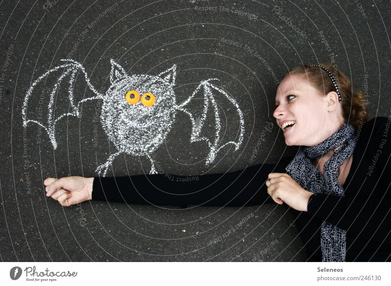 Human being Woman Youth (Young adults) Hand Animal Face Adults Playing Laughter Happy Leisure and hobbies Arm Concrete Happiness Wing To hold on
