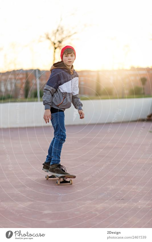 teenager practicing with skateboard at sunrise city Child Human being Youth (Young adults) Man Summer Relaxation Joy Street Adults Lifestyle Sports Boy (child)