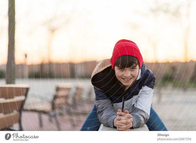 Young teenager portrait wearing a red hat Child Human being Nature Youth (Young adults) Man Young man Leaf Face Adults Lifestyle Autumn Style Happy Boy (child)