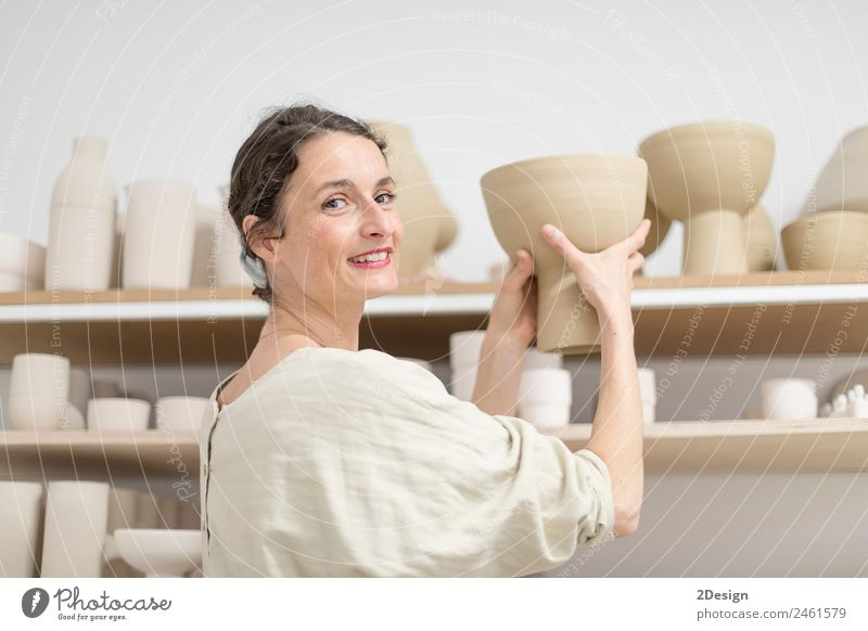 Beautiful ceramist owner looking to the camera while smiling Woman Human being Youth (Young adults) Young woman Adults Feminine Wood Business Art