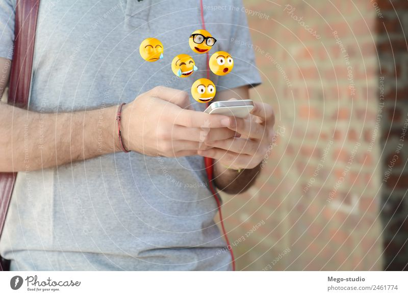 man using smartphone sending emojis. Human being Man Hand Face Adults Lifestyle Funny Emotions Happy Modern Technology Telephone Internet Model Digital PDA