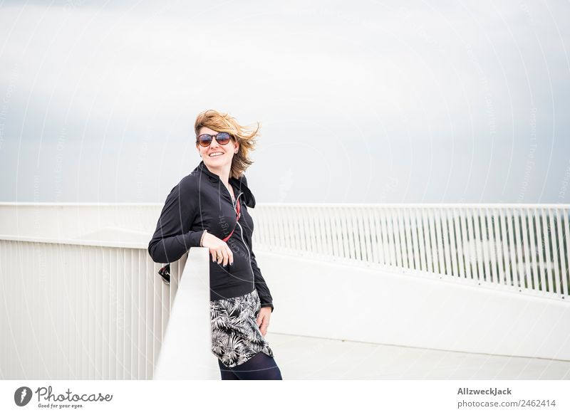 Portrait of a young woman with wind in her hair Day 1 Person Woman Feminine Young woman Portrait photograph Germany Berlin Capital city Sky Clouds Wind