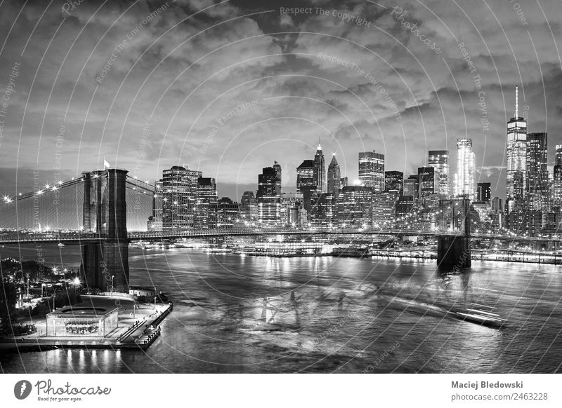 Black and white picture of New York cityscape at night. Office Sky River Town Port City Downtown Skyline High-rise Bank building Building Architecture Landmark