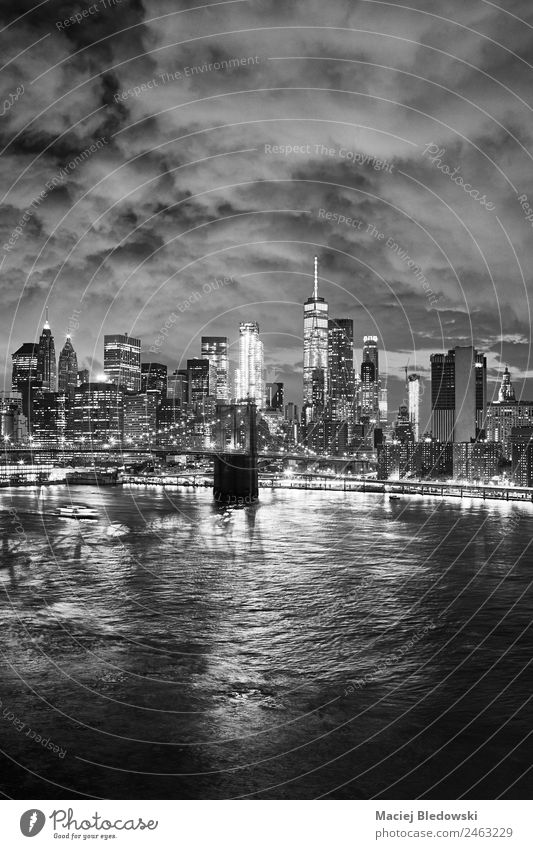 Black and white picture of the New York cityscape at night. Sky Vacation & Travel Town Architecture Building Office High-rise Vantage point Success USA Bridge
